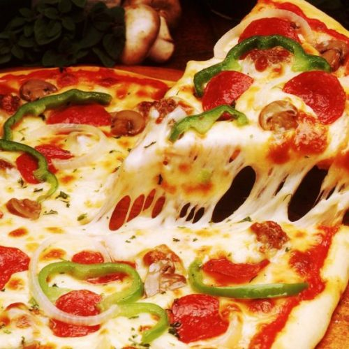 Top 4 Reasons That Will Make You Fall In Love With Pizza All Over Again